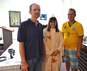 Acolyte and Leader of Song Chris Hinkle (L), Rev. Ann Penick, and Allen Rose, Chairman of the D/W Ad Hoc Committee on Women Presiders before celebrating Mass and leading a community discussion at the Dignity Center on June 28.