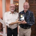 Tom Bower presents community service award to Larry Ranly at Dignity's 42nd Anniversary Dinner