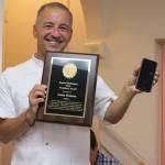 Chapter President Dan Barutta presenting award to Jamie Madson